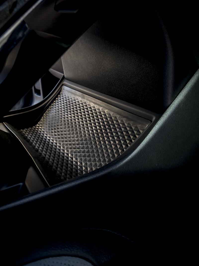 Range Rover Evoque, tout est dans le détail. Rangement sous la console centrale